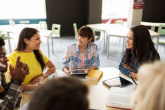 Group of high school students with tablet pc Royalty Free Stock Images