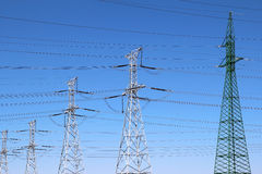Group of high voltage towers under  sky Stock Image