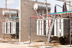 Group of high voltage transformers Royalty Free Stock Photo