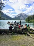 A group of hiker friends hanging out by the shores of Waterton Lake stock photo