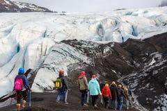 Group of hiker walk on glacier at Solheimajokull Stock Images