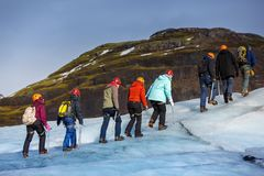Group of hiker walk on glacier at Solheimajokull Royalty Free Stock Photography
