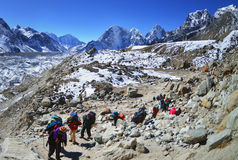 Group of hikers  with backpacks   on the trek in Himalayas Stock Photo