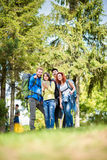 Group of hikers break off to see which is the right way to conti Royalty Free Stock Photography