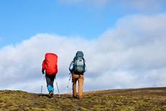 Group of hikers climbing up the mountain. Group of hikers with backpacks climbing up the mountain Stock Image