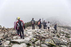 Group of hikers descending on a mountain. Royalty Free Stock Photos