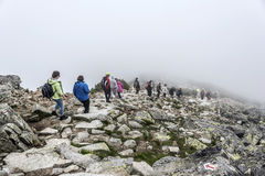 Group of hikers descending on a mountain. Royalty Free Stock Photography