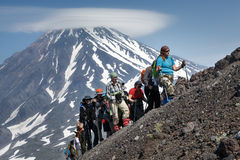 Group of hikers go hiking and climbing to the top of volcano. AVACHA VOLCANO, KAMCHATKA PENINSULA, RUSSIA - JULY 08, 2014: Hiking on Kamchatka - a group of stock photography