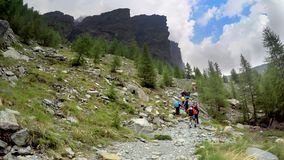 Group of hikers at hiking expedition in Alps. Mountains in France stock photography