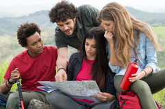 Group Of Hikers Looking The Map. Group Of Multiracial People Worried Looking The Map stock image
