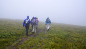Group of hikers in the mist Royalty Free Stock Photography