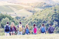 Group of hikers in the mountain in single file Royalty Free Stock Photo