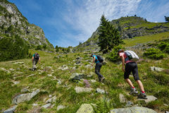 Group of hikers on a mountain trail Royalty Free Stock Photo