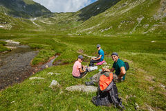 Group of hikers on a mountain trail Stock Image
