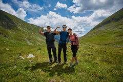 Group of hikers on a mountain trail Stock Images