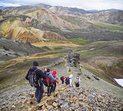 Group of hikers in the mountains. Icelandic landscape - view on amazing valley National Park Landmannalaugar royalty free stock photo