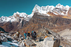 Group of Hikers and Nepalese Porter carrying many camping luggage stock images