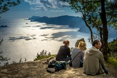 Group of hikers resting on the Path of Gods trail on Amalfi Cost, Italy stock photos