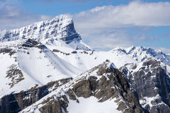 Group of hikers on top of snowy mountain peak in Canadian Rockies Royalty Free Stock Image