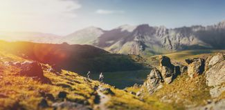 Group Of Hikers Walking Along In Summer Mountains, Journey Travel Concept. Hiking Team Goes To Mount. Travel Destination Experience Lifestyle Concept concept stock image