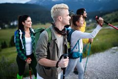 Group of hikers walking on a mountain and smiling royalty free stock photo