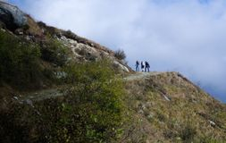 Group of hikers walking in mountains. Group of hikers walking in peak mountains Stock Photo