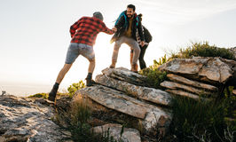 Group of hikers walking in the nature at sunset Royalty Free Stock Images