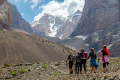 Group of Hikers Walking into Wilderness Stock Photo