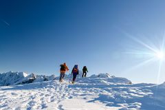 Group hikers in winter mountains, beautiful landscape and blue sky Stock Photos