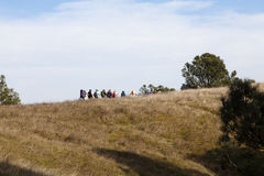 Group Of Hikes Going Up Hill Against Sky Royalty Free Stock Photography