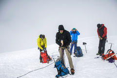Group Hiking glacier Hvannadalshnukur summit in Iceland mountain landscape Vatnajokull park foggy Royalty Free Stock Photos