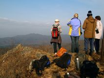 Group of hiking people. Fall mountain landscape with group of hiking people on the mountain top Royalty Free Stock Photos