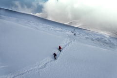 Group hiking on snow-covered mountains in winter Stock Images