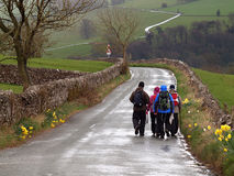 Group Hiking on a Wet Day. Group walking in Peak District Park on a wet spring day stock photo