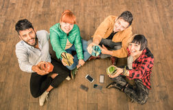 Group of hipster best friends with smartphones and drinks. Group of hipster best friends with smartphones in grungy alternative location - Young entrepreneurs Stock Photos