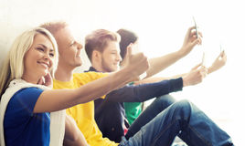 Group of hipsters taking selfie. Students on a break. Group of hipsters taking selfie. Happy teenage students on a break at school Royalty Free Stock Images