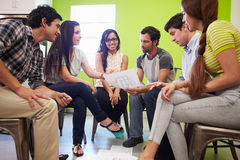 Group Of Hispanic Designers Meeting To Discuss New Ideas Royalty Free Stock Photos