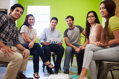 Group Of Hispanic Designers Meeting To Discuss New Ideas Stock Photography