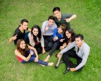 Group of hispanic teens thumbing up outdoors.  Royalty Free Stock Photography