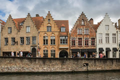 A group of historic brick gabled buildings by the canal in central Bruges. Stock Images