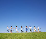 Group Holding hands running Royalty Free Stock Images