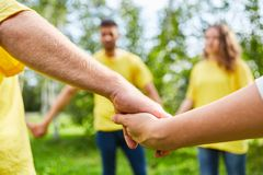 Group is holding hands at teambuilding Stock Photography