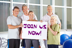 Group holding Join us now sign Royalty Free Stock Photo