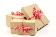 Group of holiday gift boxes decorated with ribbon isolated on wh. Holiday gift boxes decorated with ribbon isolated on white background Royalty Free Stock Image