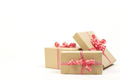 Group of holiday gift boxes decorated with ribbon isolated on white background. Stock Image