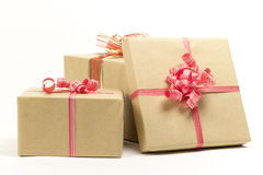 Group of holiday gift boxes decorated with ribbon isolated on white background. A group of holiday gift boxes decorated with ribbon isolated on white background Stock Images