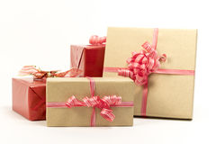 Group of holiday gift boxes decorated with ribbon isolated on white background. Royalty Free Stock Images