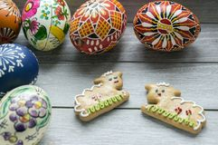 Group of homemade and handmade Easter eggs and two gingerbread lambs stock images