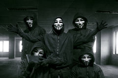 Group of hooded hacker with mask standing Royalty Free Stock Image