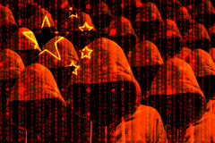 Group of hooded hackers shining through a digital chinese flag. Cybersecurity concept royalty free stock photo